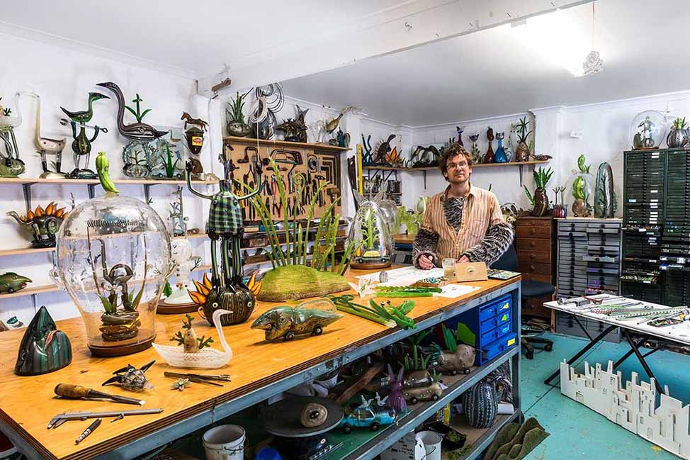 Tom Moore in his studio, surrounded by his fantastical creations.