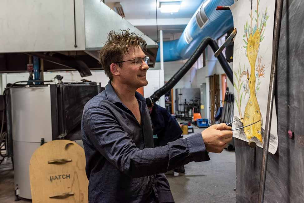 Tom Moore at work in his glass blowing studio