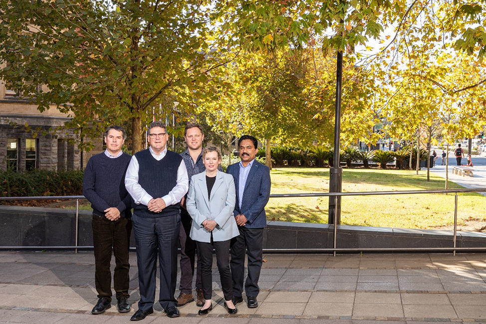 Dr Brenton Hordacre (centre) and his fellow mental health researchers as part of UniSA's Enterprising Minds for Mental Health