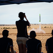 Image of participants watching a rocket being lauched