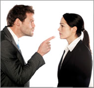 Employer pointing his finger in anger at employee