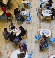 Elevated view of people at an open cafe