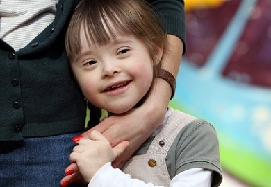 Girl with Down Syndrome and mother