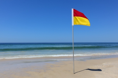 red and yellow flag on beach