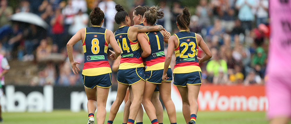 Adelaide Crows Women's team celebrating a goal