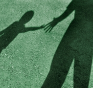 Shadows of a child and adult.
