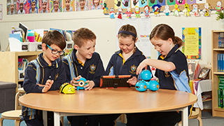 St Joseph's Year 3 students – Sebastian Wallace, James Sampson, Monique Read and Madeline Tarbard – sharing new technologies with Immanuel student Daisy Davidson.
