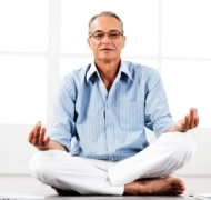 Mature man meditates