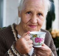 Older woman drinking a cup of tea