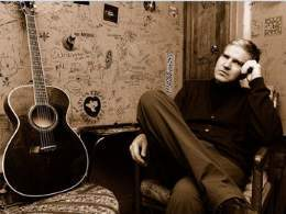 Singer songwriter Lloyd Cole with guitar