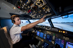 A UniSA pilot student in the UniSA Boeing 737N flight simulator at Mawson Lakes Campus