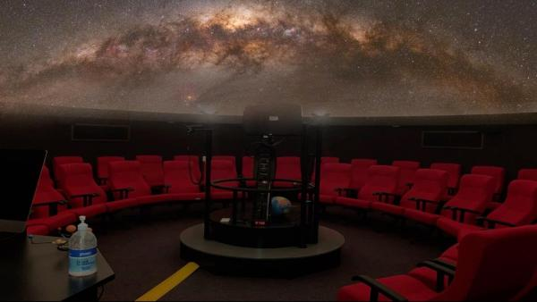 A starfield is projected above the planetarium