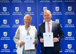 Professor Allan Evans with Nobel Laureate Professor Muhammad Yunus signing an MOU to deliver a Social Business Centre at UniSA.