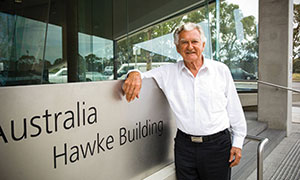 Bob Hawke standing outside the Hawke Building.