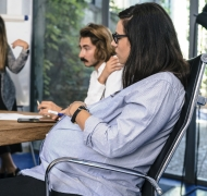 Pregnant woman discusses strategy with research team