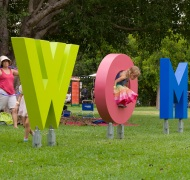 Man walking past WOMAD sign