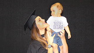 UniSA graduate Ania Craus, who recently completed her master's degree, with her son, Manwel.