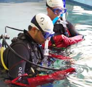 Students preparing for a space training underwater.