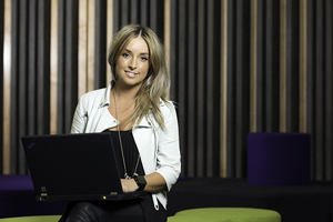 Image of an IT student in a student lounge space at UniSA Mawson Lakes Campus