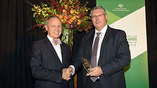 Dr Peter Balan OAM with Deputy Secretary, Department of Education and Training, David Learmonth.
