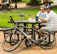Older cyclists share a picnic lunch