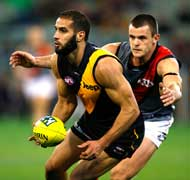 The AFL's Richmond defender, Bachar Houli and Kelvin Grove Urban Village's eXchange group.