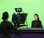 Students working in television studio