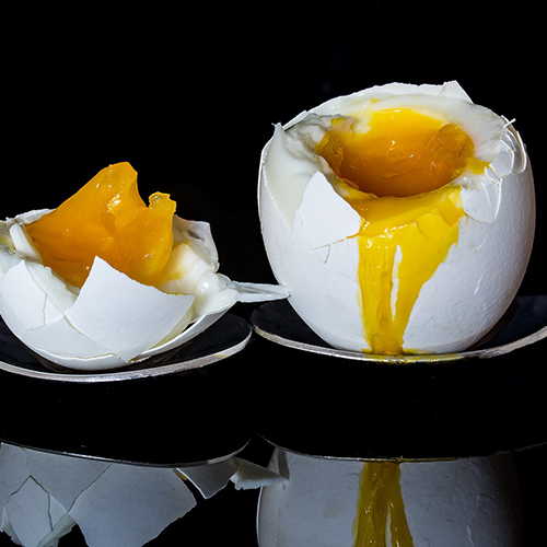 two boiled eggs in egg cups