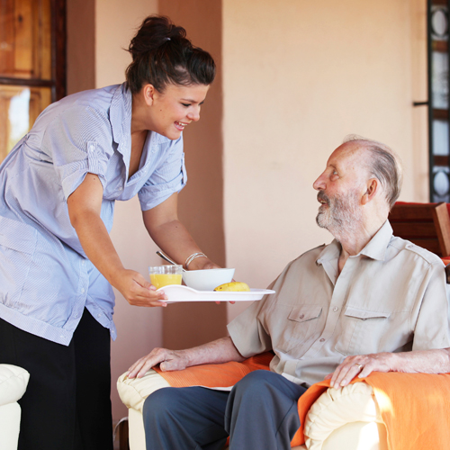 Man receiving a meal in a nursing home