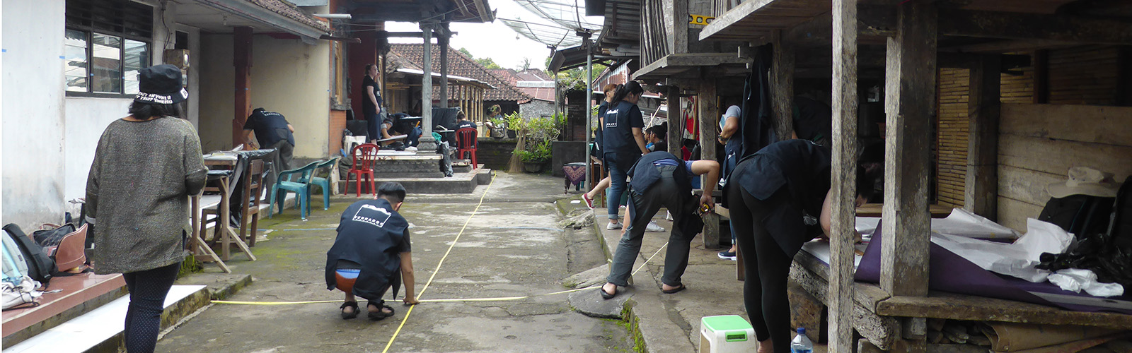 Participants measuring up for drawing in the family compound at Desa Pedawa
