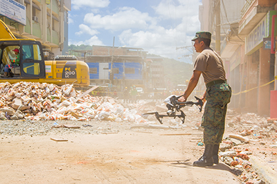 A drone is used by the Ecuadorian army to search for survivors after a 7.8 earthquake Portoviejo, Ecuador in April 2016. Researchers from UniSA and Middle Technical University have developed a more accurate camera system to detect signs of life. Photo: Fotos593 / Shutterstock.com